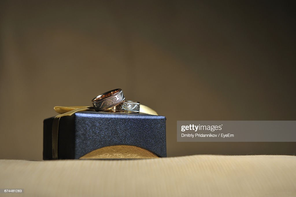 Close-Up Of Wedding Rings On Gift Box : Stock Photo