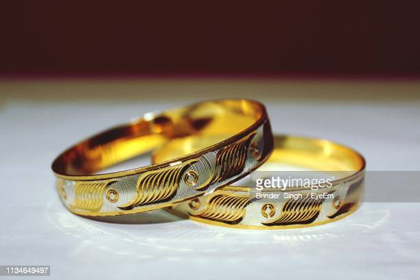 close-up of wedding rings on table - bangle stock pictures, royalty-free photos & images