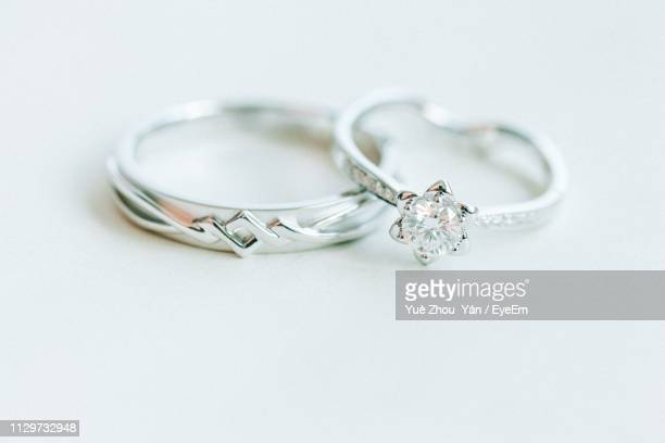close-up of wedding rings on white background - 結婚指輪 ストックフォトと画像