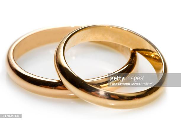 close-up of wedding rings on white background - ring stock pictures, royalty-free photos & images