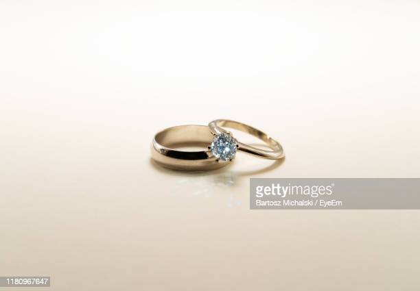 close-up of wedding rings on white background - married stock pictures, royalty-free photos & images
