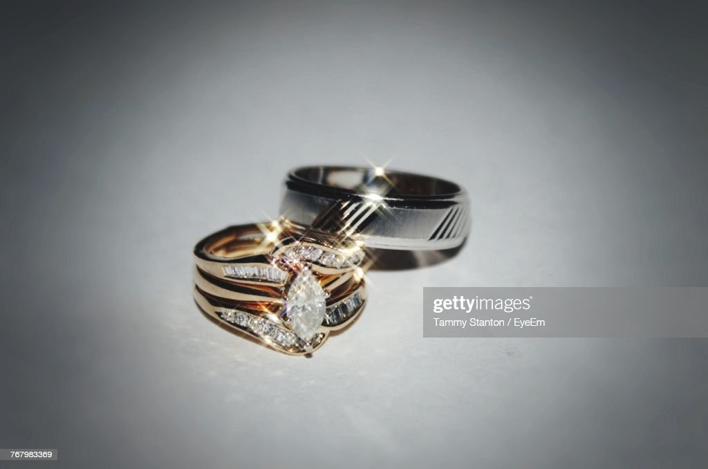 Close Up Of Wedding Rings Over White Background Stock Photo