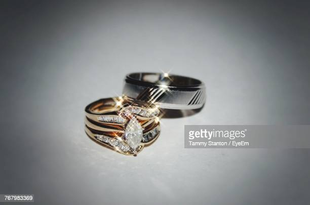 Close-Up Of Wedding Rings Over White Background