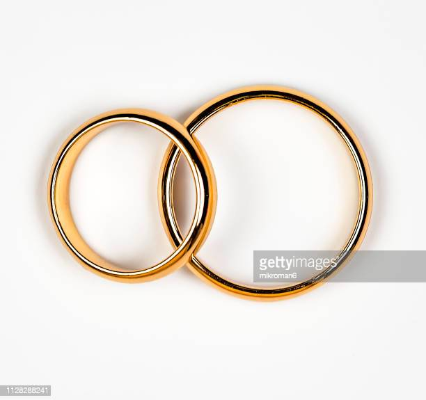 close-up of wedding rings - wedding ring stock pictures, royalty-free photos & images