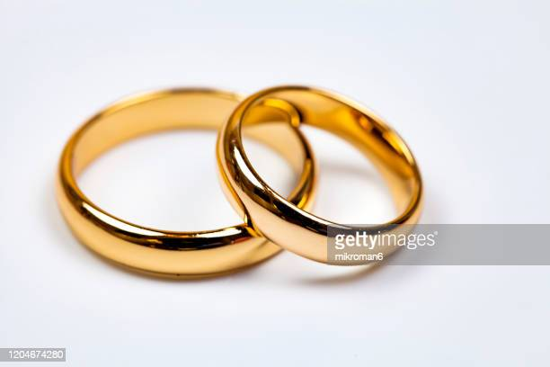 close-up of wedding rings - man made object stock pictures, royalty-free photos & images