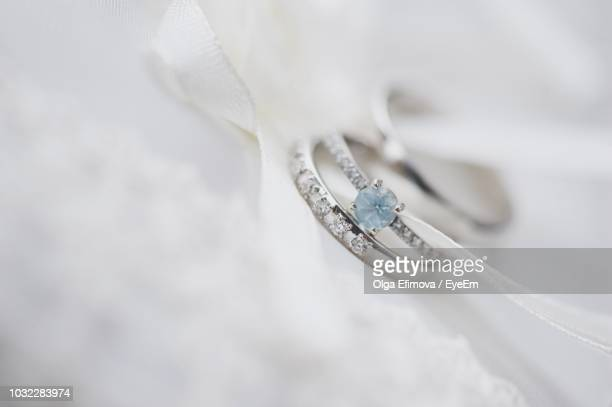 close-up of wedding rings with textile - 結婚指輪 ストックフォトと画像