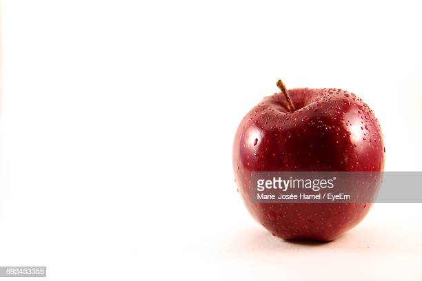 Close-Up Of Wet Apple On White Background