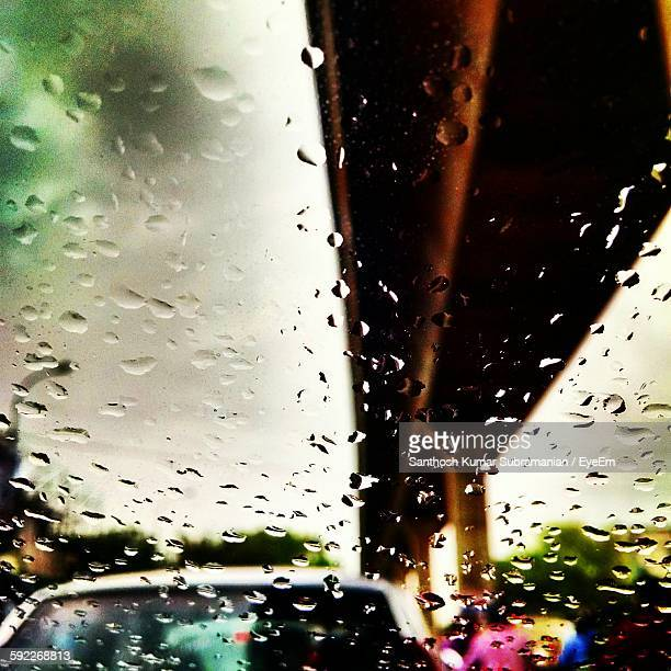 close-up of wet car windshield against sky during rainy season - chennai stock pictures, royalty-free photos & images