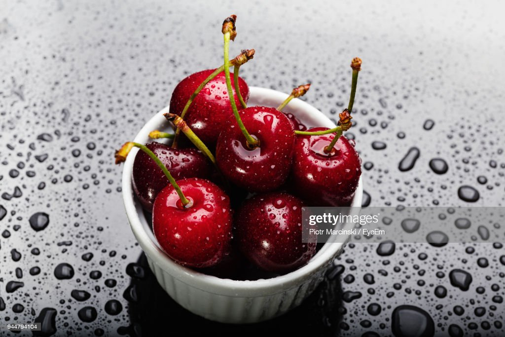 Close-Up Of Wet Cherries Over Black Background : Stock Photo