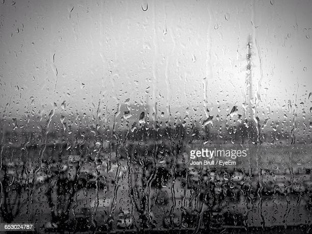 close-up of wet glass window during rainy season - sant joan despí stock pictures, royalty-free photos & images