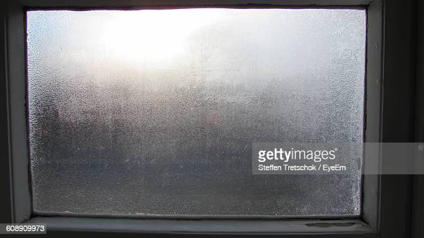Close-Up Of Wet Glass Window