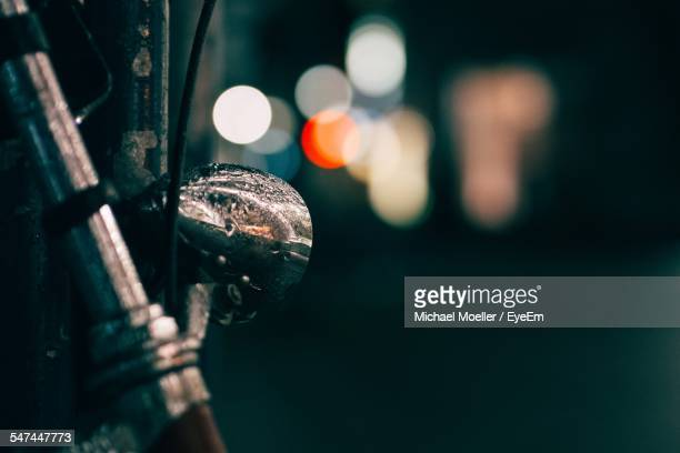 Close-Up Of Wet Headlight Of Bicycle At Night
