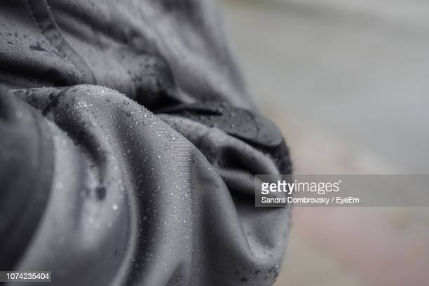 close-up of wet jacket - jak jas stockfoto's en -beelden