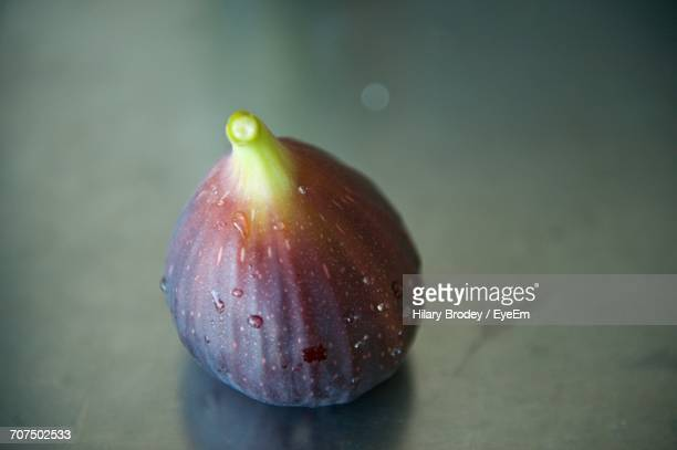 Close-Up Of Wet Ripe Fig On Table