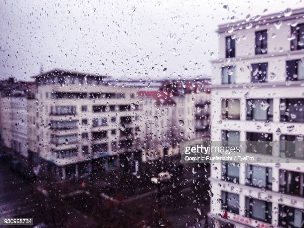 close-up of wet window in rainy season - regentropfen stock-fotos und bilder