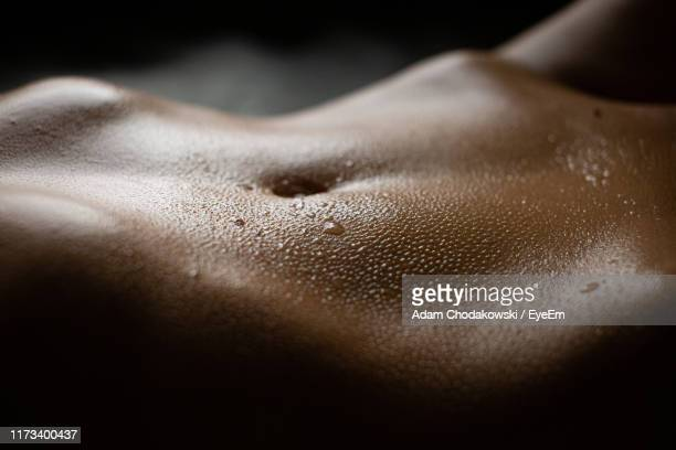 close-up of wet woman on black background - wet stock pictures, royalty-free photos & images