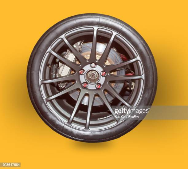 Close-Up Of Wheel On Yellow Background