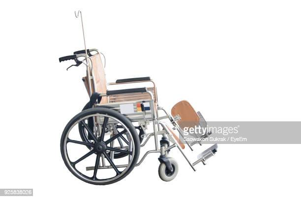 close-up of wheelchair against white background - 車いす ストックフォトと画像