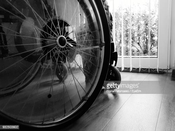 Close-Up Of Wheelchair On Hardwood Floor At Home