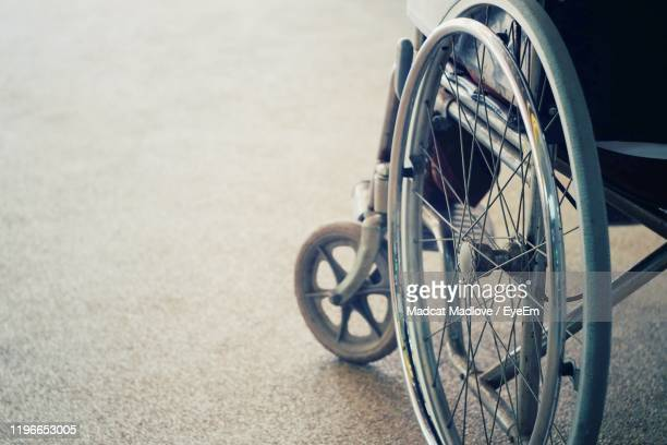 close-up of wheelchair on road - wheel stock pictures, royalty-free photos & images