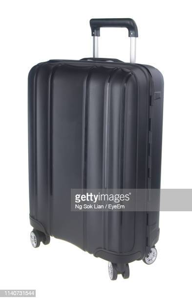 close-up of wheeled luggage against white background - valise photos et images de collection
