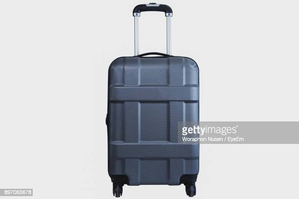 Close-Up Of Wheeled Luggage Against White Background