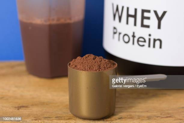 close-up of whey protein in spoon on table - protein drink stock pictures, royalty-free photos & images