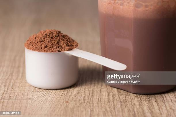 Close-Up Of Whey Protein In Spoon On Table