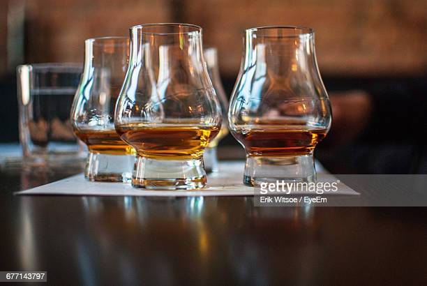 Close-Up Of Whiskey Glasses On Table In Bar