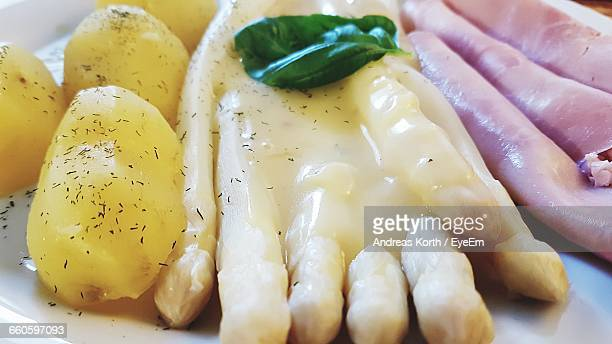 Close-Up Of White Asparagus And Potatoes In Plate