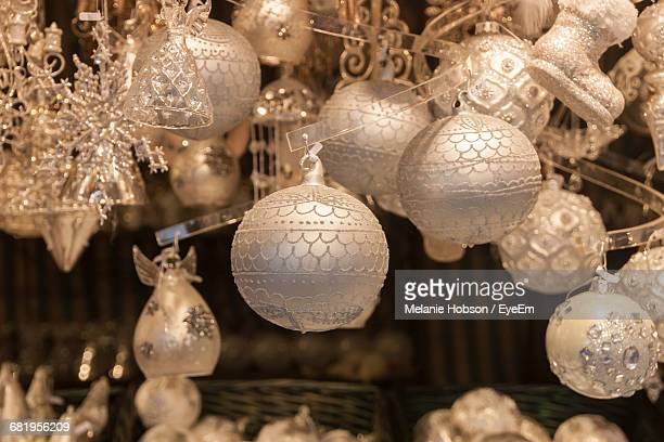 Close-Up Of White Christmas Bauble Hanging At Store