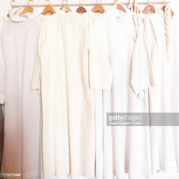 close-up of white clothes hanging in store - 白い服 ストックフォトと画像