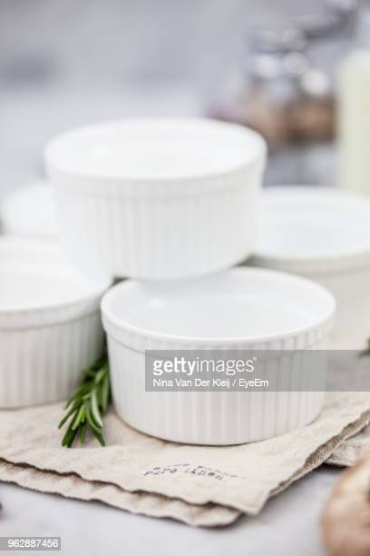 Close-Up Of White Containers In Napkin On Table