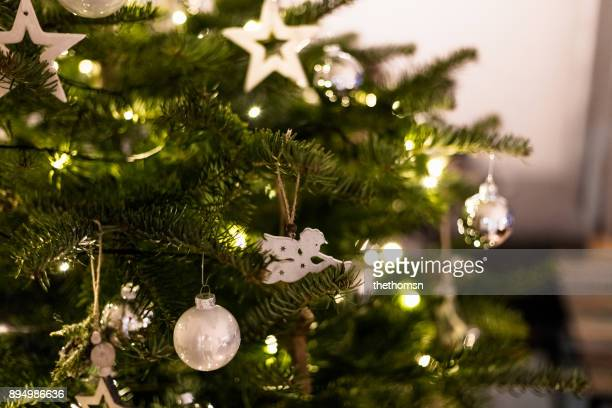 Close-up of white decorated christmas tree in living room, Germany