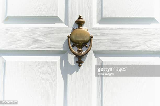 close-up of white door with knocker - door knocker stock photos and pictures