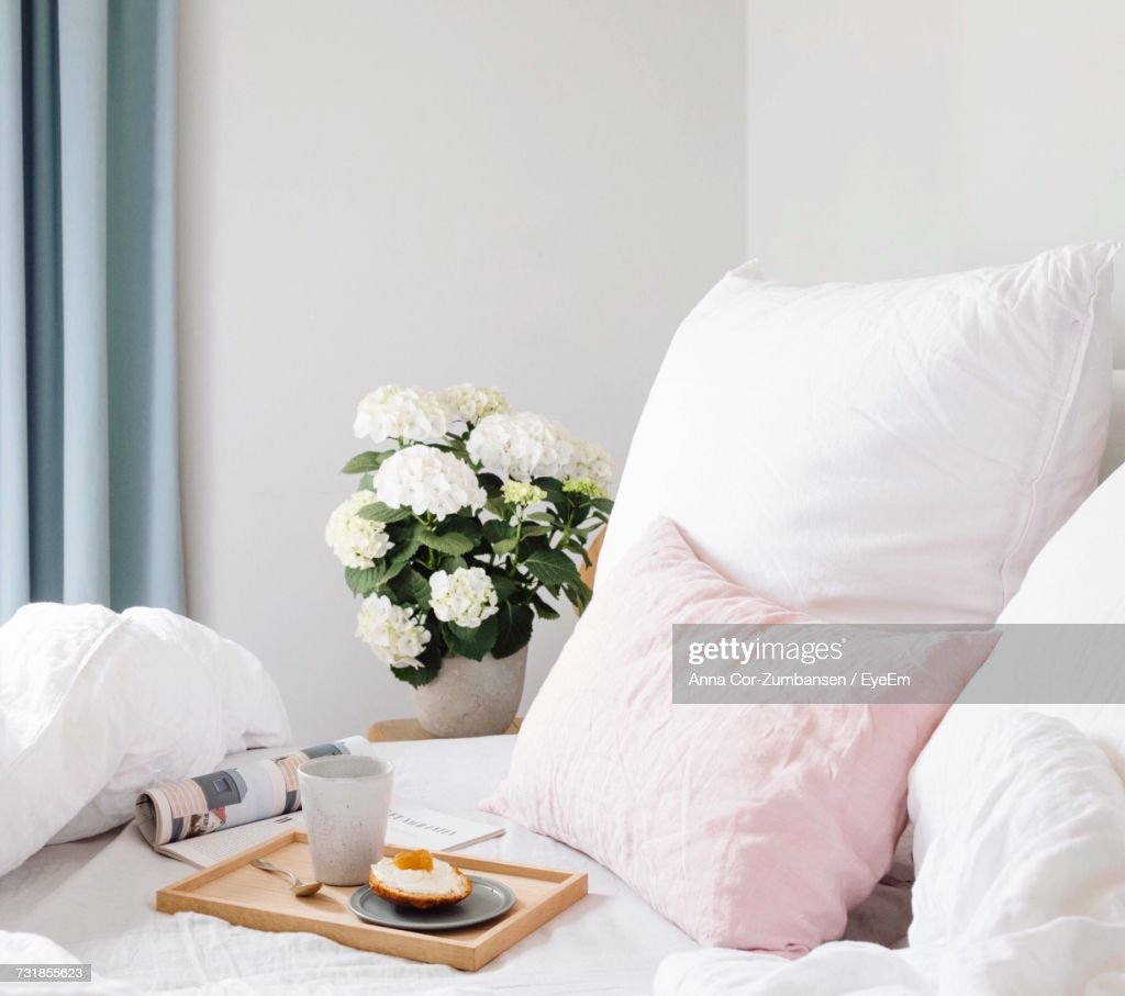 Closeup Of White Flowers In Vase On Bed Stock Photo Getty Images