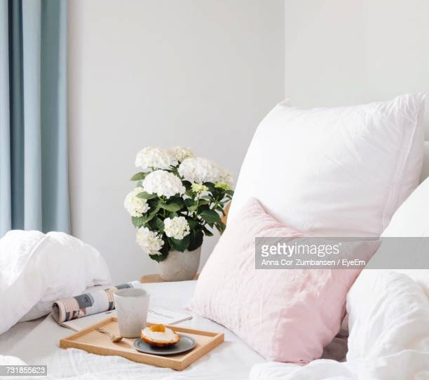 close-up of white flowers in vase on bed - breakfast in bed stock pictures, royalty-free photos & images