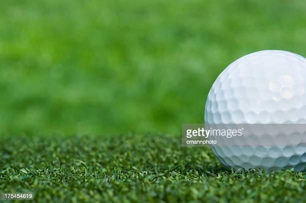 Close-up of white golf ball on the green