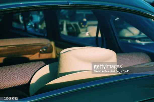 Close-Up Of White Hat In Car Seen Through Window
