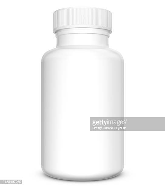close-up of white medicine bottle against white background - pill bottle stock pictures, royalty-free photos & images