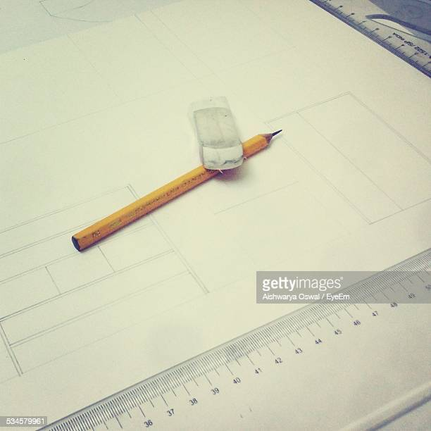 Close-Up Of White Paper With Equipment