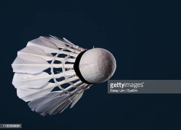 close-up of white shuttlecock against black background - shuttlecock stock pictures, royalty-free photos & images