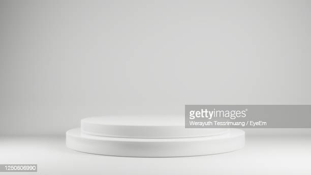 close-up of white stage under studio room - winners podium stock pictures, royalty-free photos & images