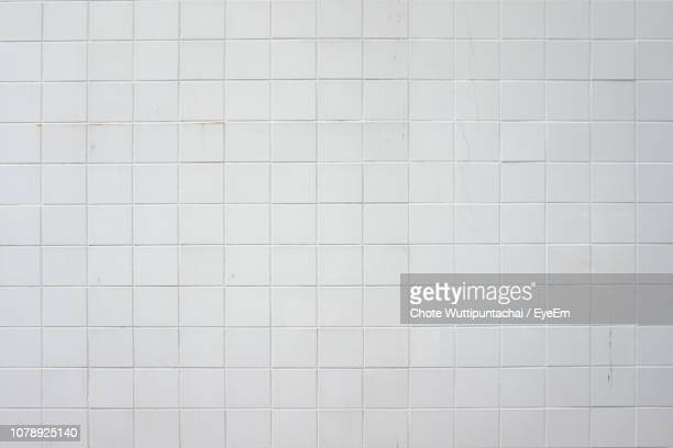 close-up of white tiled wall - bathroom stock photos and pictures