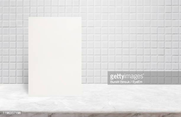 close-up of white tiled wall - tiled floor stock pictures, royalty-free photos & images