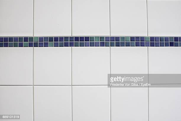 Close-Up Of White Tiled Wall