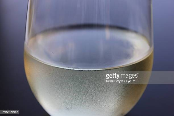 Close-Up Of White Wine In Glass