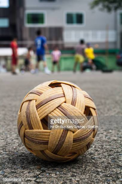 close-up of wicker ball on street - wicker stock pictures, royalty-free photos & images