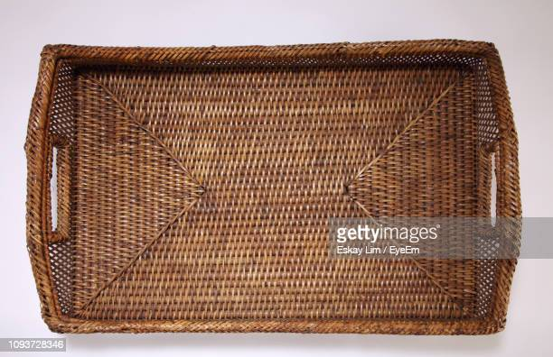close-up of wicker basket against white background - wicker stock pictures, royalty-free photos & images