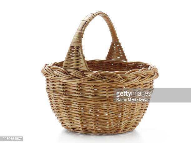 close-up of wicker basket against white background - basket stock pictures, royalty-free photos & images
